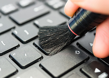 Person brushing keyboard